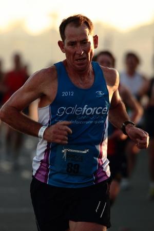 september 2: BRISBANE, AUSTRALIA - SEPTEMBER 02 : Christopher Love runners  participating in the Bridge to Brisbane charity fun run on September 02, 2012 in Brisbane, Australia