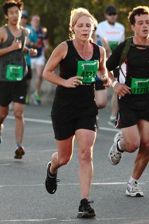 BRISBANE, AUSTRALIA - SEPTEMBER 02 : Unidentified runners  participating in the Bridge to Brisbane charity fun run on September 02, 2012 in Brisbane, Australia Stock Photo - 15269689
