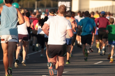 BRISBANE, AUSTRALIA - SEPTEMBER 02 : Unidentified runners  participating in the Bridge to Brisbane charity fun run on September 02, 2012 in Brisbane, Australia Editorial