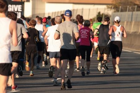 BRISBANE, AUSTRALIA - SEPTEMBER 02 : Unidentified runners  participating in the Bridge to Brisbane charity fun run on September 02, 2012 in Brisbane, Australia Stock Photo - 15269694