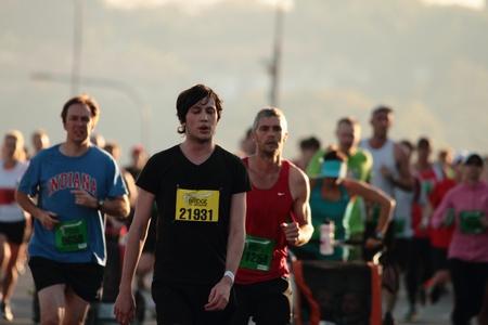 BRISBANE, AUSTRALIA - SEPTEMBER 02 : Unidentified runners  participating in the Bridge to Brisbane charity fun run on September 02, 2012 in Brisbane, Australia Stock Photo - 15269698