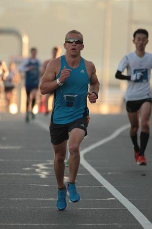 action fund: BRISBANE, AUSTRALIA - SEPTEMBER 02 : Tom Beechey  participating in the Bridge to Brisbane charity fun run on September 02, 2012 in Brisbane, Australia