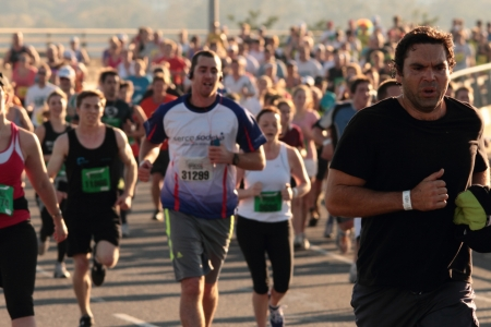 BRISBANE, AUSTRALIA - SEPTEMBER 02 : Unidentified runners  participating in the Bridge to Brisbane charity fun run on September 02, 2012 in Brisbane, Australia Stock Photo - 15269734