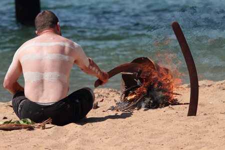 lame: BRISBANE, AUSTRALIA - SEPTEMBER 16 : Unidentified aboriginal man conducting fire ceremony as part of the Redcliffe First Settlement Festival on September 16, 2012 in Brisbane, Australia
