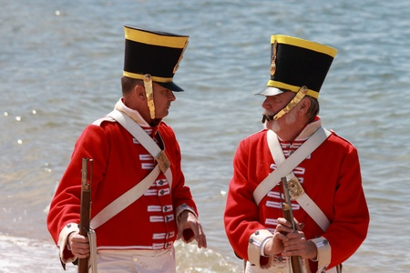 lame: BRISBANE, AUSTRALIA - SEPTEMBER 16 : Unidentified men in soldier re-enactment costume milling as part of the Redcliffe First Settlement Festival on September 16, 2012 in Brisbane, Australia