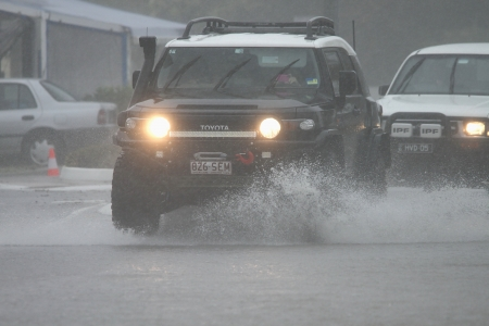 BRISBANE, AUSTRALIA - JANUARY 27 : Four wheel drives crossing flooded roads during tropical cyclone Oswald on January 27, 2013 in Brisbane, Australia