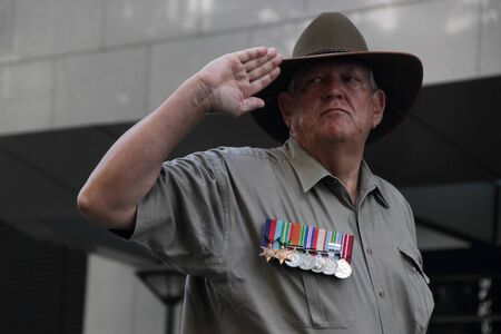 salutes: BRISBANE, AUSTRALIA - APRIL 25 : Veteran salutes during march as part of  Anzac day commemorations  April 25, 2013 in Brisbane, Australia Editorial