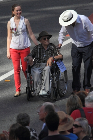 centenarian: BRISBANE, AUSTRALIA - APRIL 25 : 104 yr old veteran Ken Blake pushed in wheelchair during along march route during Anzac day commemorations  April 25, 2013 in Brisbane, Australia Editorial