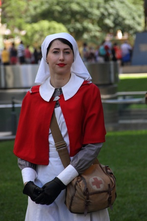 reenactor: BRISBANE, AUSTRALIA - APRIL 25 : Unidentified World War 2 nurse reenactor poses during Anzac day commemorations  April 25, 2013 in Brisbane, Australia