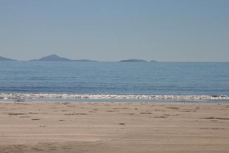 airlie: sandy Smalleys Beach and Beachcomber Cove area Cape Hillsborough national park queensland australia looking towards brampton island