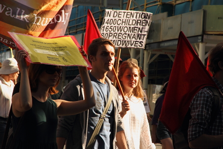 BRISBANE, AUSTRALIA - JUNE 22   Anti governement  immigration policy protesters marching streets during World Refugee Rally June 22, 2014 in Brisbane, Australia