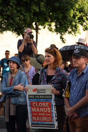 detention: BRISBANE, AUSTRALIA - JUNE 22   Unidentified protester holding sign demanding closing of manus island and nura detention centres whilst attending World Refugee Rally June 22, 2014 in Brisbane, Australia