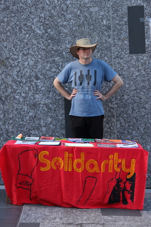 abbott: BRISBANE, AUSTRALIA - JUNE 22 : Unidentified man attending solidarirty polictical party booth at World Refugee Rally June 22, 2014 in Brisbane, Australia Editorial
