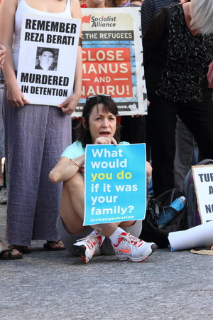 governement: BRISBANE, AUSTRALIA - JUNE 22 : Unidentified protesters holding anti governement policy signs at World Refugee Rally June 22, 2014 in Brisbane, Australia Editorial