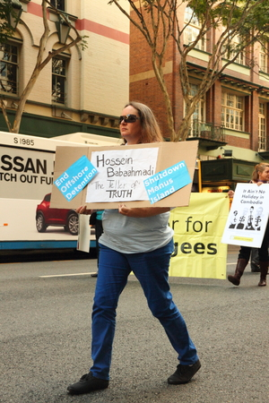 berate: BRISBANE, AUSTRALIA - JUNE 22 : Anti governement  immigration policy protesters marching streets during World Refugee Rally June 22, 2014 in Brisbane, Australia Editorial