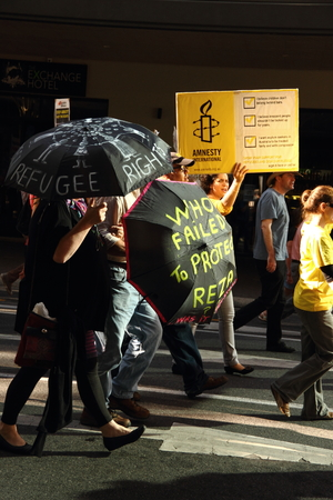 BRISBANE, AUSTRALIA - JUNE 22 : Anti governement  immigration policy protesters marching streets during World Refugee Rally June 22, 2014 in Brisbane, Australia