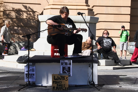 governement: BRISBANE, AUSTRALIA - JULLY 06 : Jenny Pineapple performs at the  Bust The Budget anti liberal governement Rally July 06, 2014 in Brisbane, Australia Editorial