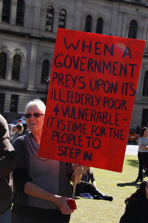 governement: BRISBANE, AUSTRALIA - JULLY 06 : Val Lack protesting at Bust The Budget anti liberal governement Rally July 06, 2014 in Brisbane, Australia Editorial