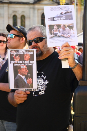 anti fascist: BRISBANE, AUSTRALIA - JULLY 06 : Unidentified protester with with anti liberal government posters at Bust The Budget Rally July 06, 2014 in Brisbane, Australia