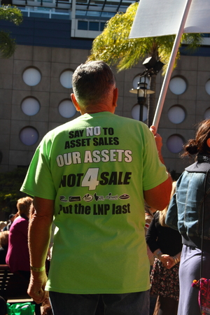 poorer: BRISBANE, AUSTRALIA - JULLY 06 : Unidentified protester wearing anti privatisation shirt at Bust The Budget anti liberal governement Rally July 06, 2014 in Brisbane, Australia