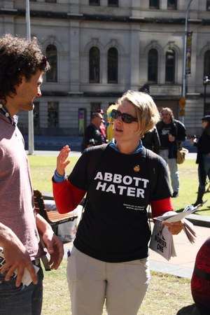 BRISBANE, AUSTRALIA - JULLY 06 : Unidentified protester wearing anti prime minister shirt destibuting flyers at Bust The Budget Rally July 06, 2014 in Brisbane, Australia Editorial