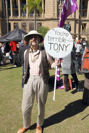 ged: BRISBANE, AUSTRALIA - JULLY 06 : Ged Maybury with anti prime minister sign at Bust The Budget anti liberal governement Rally July 06, 2014 in Brisbane, Australia Editorial