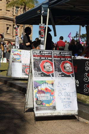 anti fascist: BRISBANE, AUSTRALIA - JULLY 06 : Socialist Alliance stand at Bust The Budget anti liberal governement Rally July 06, 2014 in Brisbane, Australia