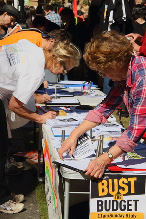 BRISBANE, AUSTRALIA - JULLY 06 : Unidentified  older Australians signing budget petition at Bust The Budget anti liberal governement Rally July 06, 2014 in Brisbane, Australia