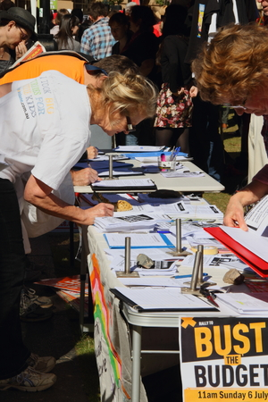 governement: BRISBANE, AUSTRALIA - JULLY 06 : Unidentified  older Australians signing budget petition at Bust The Budget anti liberal governement Rally July 06, 2014 in Brisbane, Australia