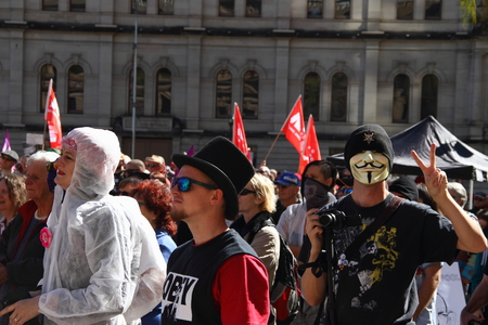 poorer: BRISBANE, AUSTRALIA - JULLY 06 : Unidentified people listening  to speakers at Bust The Budget anti liberal governement Rally July 06, 2014 in Brisbane, Australia