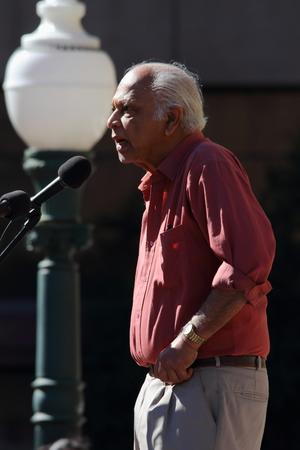 governement: BRISBANE, AUSTRALIA - JULLY 06 : Dr Brian Senewiratne speaking at Bust The Budget anti liberal governement Rally July 06, 2014 in Brisbane, Australia