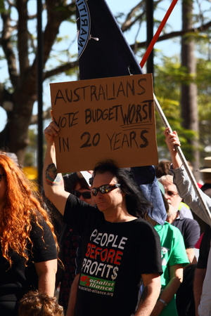 poorer: BRISBANE, AUSTRALIA - JULY 06 : Unidentified protester anti budget with sign at Bust The Budget anti liberal governement Rally July 06, 2014 in Brisbane, Australia