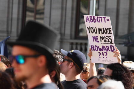 abbott: BRISBANE, AUSTRALIA - JULY 06 : Unidentified protester with anti prime minister Abbott sign at Bust The Budget  Rally July 06, 2014 in Brisbane, Australia Editorial