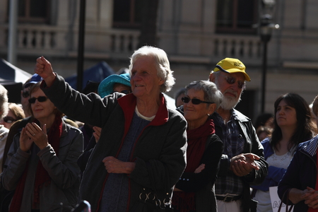 anti fascist: BRISBANE, AUSTRALIA - JULY 06 : Unidentified older Australians applauding the speakers  at Bust The Budget anti liberal governement Rally July 06, 2014 in Brisbane, Australia