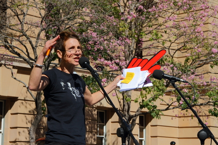 poorer: BRISBANE, AUSTRALIA - JULY 06 : Activist Robin Taubenfeld  speaking at Bust The Budget anti liberal governement Rally July 06, 2014 in Brisbane, Australia Editorial