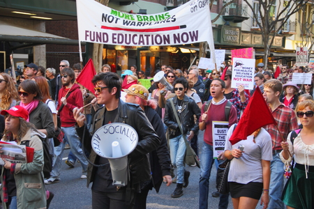 poorer: BRISBANE, AUSTRALIA - JULY 06 : Unidentified protesters marching during Bust The Budget anti liberal governement Rally July 06, 2014 in Brisbane, Australia Editorial