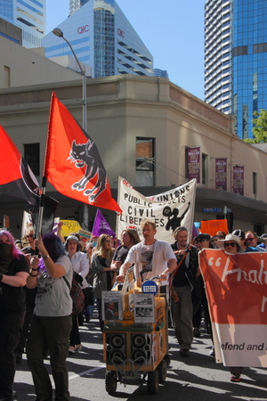 anti fascist: BRISBANE, AUSTRALIA - JULY 06 : Unidentified protesters marching during Bust The Budget anti liberal governement Rally July 06, 2014 in Brisbane, Australia Editorial
