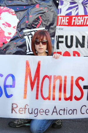 morrison: BRISBANE, AUSTRALIA - JULY 12 : Unidentified protester with anti government refugee policy sign outside Liberal National Party national conerfence July 12, 2014 in Brisbane, Australia Editorial
