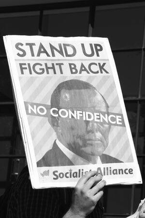 abbott: BRISBANE, AUSTRALIA - JULY 12 : Unidentified protester with anti Abbott sign outside Liberal National Party national conerfence July 12, 2014 in Brisbane, Australia Editorial