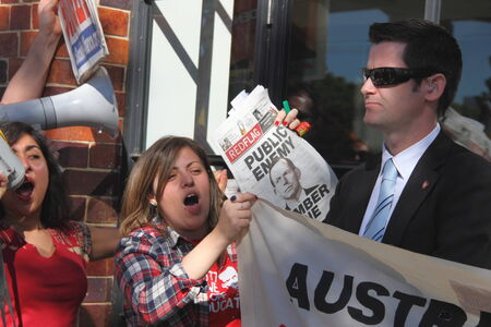 BRISBANE, AUSTRALIA - JULY 12 : Unidentified anti government protesters confronted by federal police outside Liberal National Party national conerfence July 12, 2014 in Brisbane, Australia