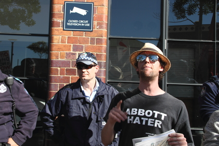 abbott: BRISBANE, AUSTRALIA - JULY 12 : Unidentified anti government protester with abbott hater shirt outside Liberal National Party national conerfence July 12, 2014 in Brisbane, Australia