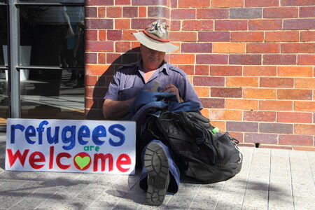 anti fascist: BRISBANE, AUSTRALIA - JULY 12 : Unidentified protester with anti refugee policy sign outside Liberal National Party national conerfence July 12, 2014 in Brisbane, Australia
