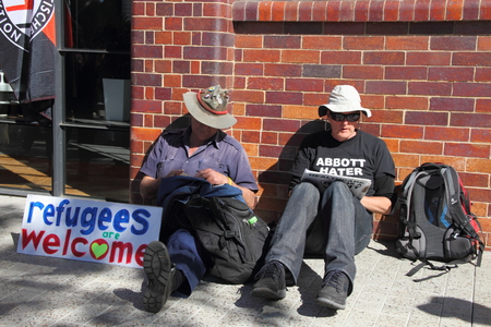 poorer: BRISBANE, AUSTRALIA - JULY 12 : Unidentified protesters with anti refugee policy sign outside Liberal National Party national conerfence July 12, 2014 in Brisbane, Australia Editorial
