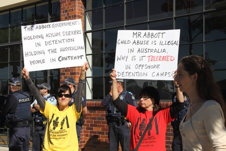 morrison: BRISBANE, AUSTRALIA - JULY 12 : Unidentified protesters with anti refugee policy signs outside Liberal National Party national conerfence July 12, 2014 in Brisbane, Australia