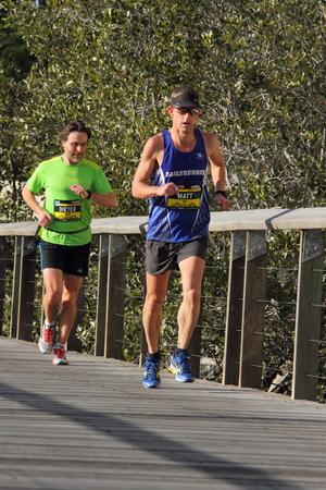 matt: BRISBANE, AUSTRALIA - AUGUST 03 Competitor Matt Archer and unidentified others in Brisbane Marathon August 03, 2014 in Brisbane, Australia