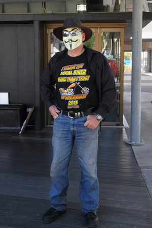 CABOOLTURE, AUSTRALIA - AUGUST 30: Unidentified anti LNP government with anonymous mask and pro bikie shirt at March Australia Rally August 30, 2014 in Caboolture, Australia