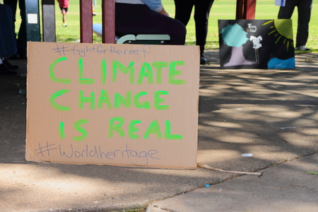 climate change: CABOOLTURE, AUSTRALIA - AUGUST 30: Anti LNP government enviroment policies sign shirt at March Australia Rally August 30, 2014 in Caboolture, Australia