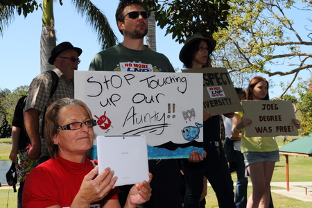abbott: CABOOLTURE, AUSTRALIA - AUGUST 30: Unidentified protesters with anti LNP government signs at March Australia Rally August 30, 2014 in Caboolture, Australia Editorial
