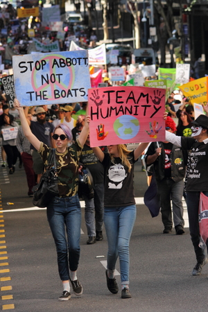 abbott: BRISBANE, AUSTRALIA - AUGUST 31: Unidentified protesters with anti Abbott Team Australia and refugee policy signs at March Australia Rally August 31, 2014 in Brisbane, Australia