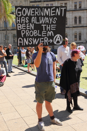 BRISBANE, AUSTRALIA - AUGUST 31: Unidentified protesters with pro anarchy sign at March Australia Rally August 31, 2014 in Brisbane, Australia